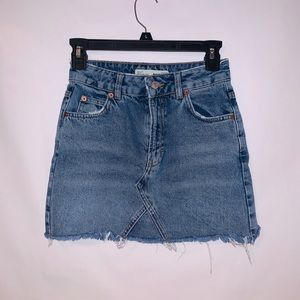 TOPSHOP DISTRESSED JEAN SKIRT